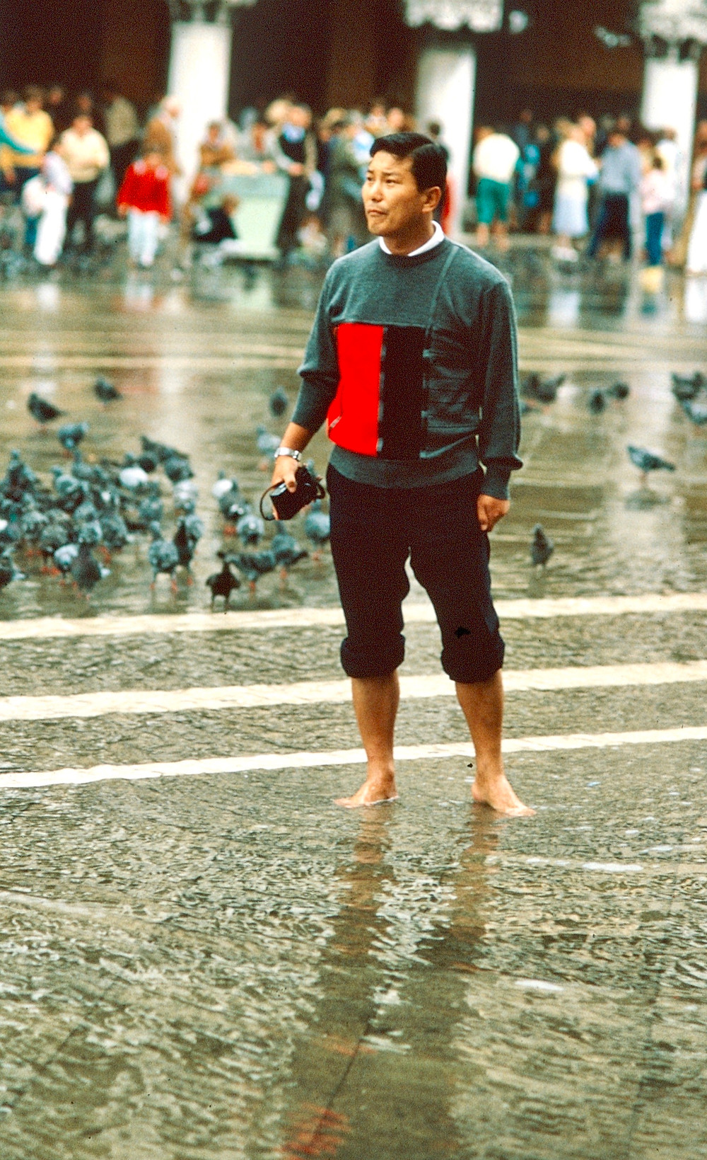 Japanese tourist in flooded San Marco square 1980