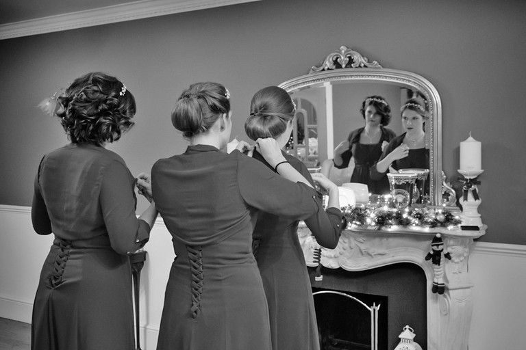 bridesmaids prepare for a christmas wedding day