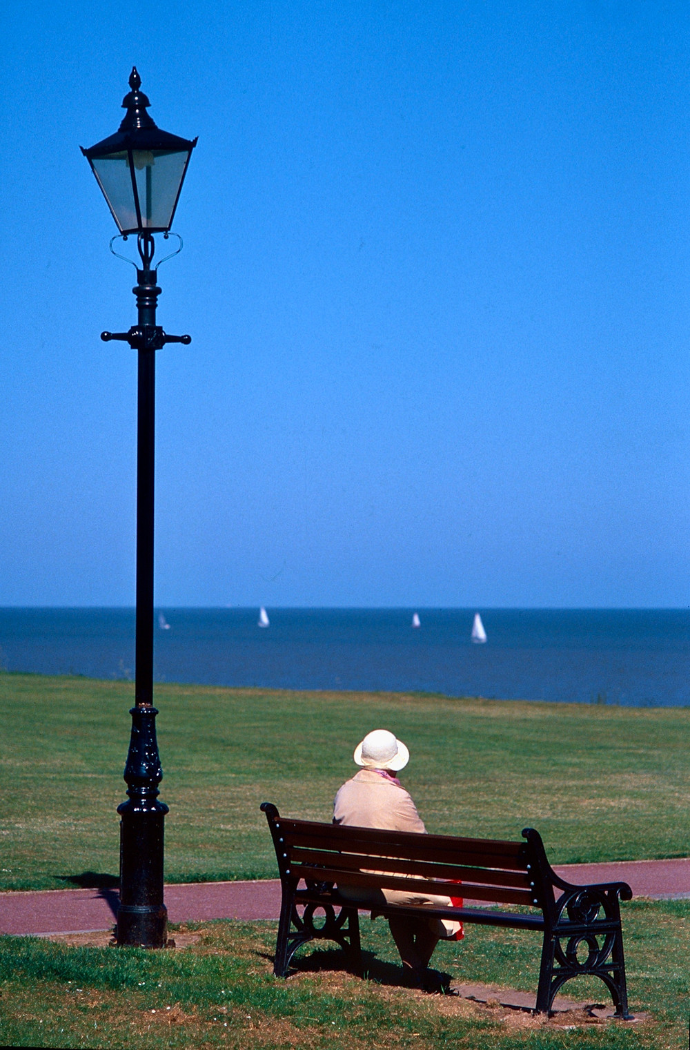 Lady on bench looking out to see