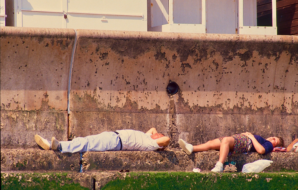 untidy sunbathing on concrete