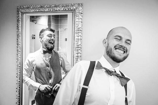 humorous moment as groom dresses for wedding