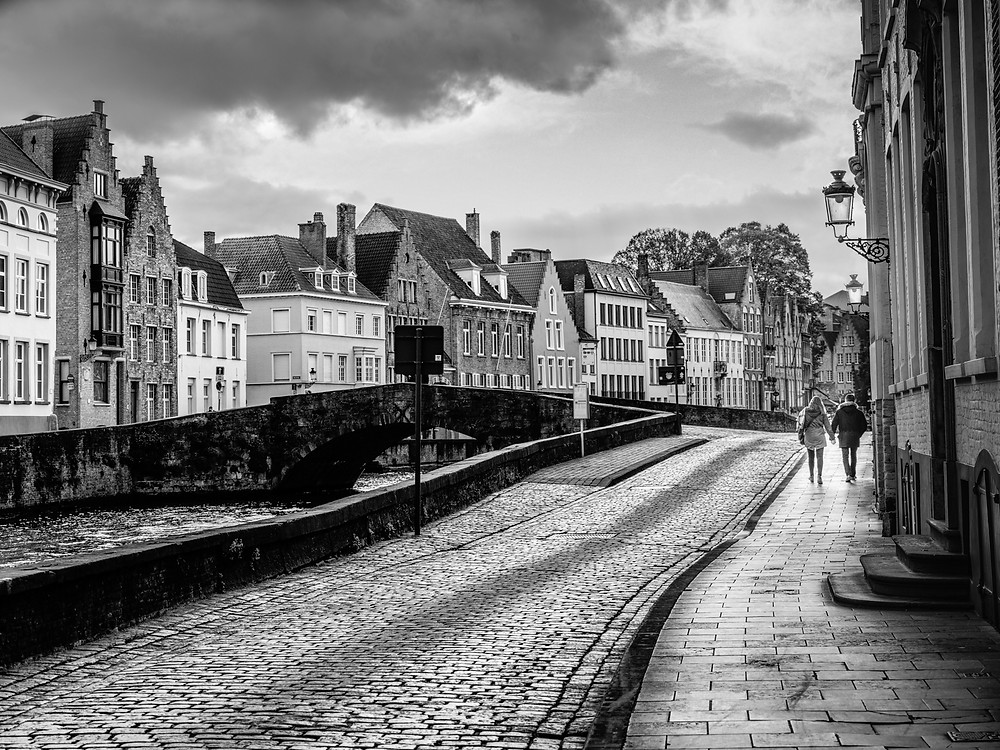 Monochrome image of canal walk in Bruges