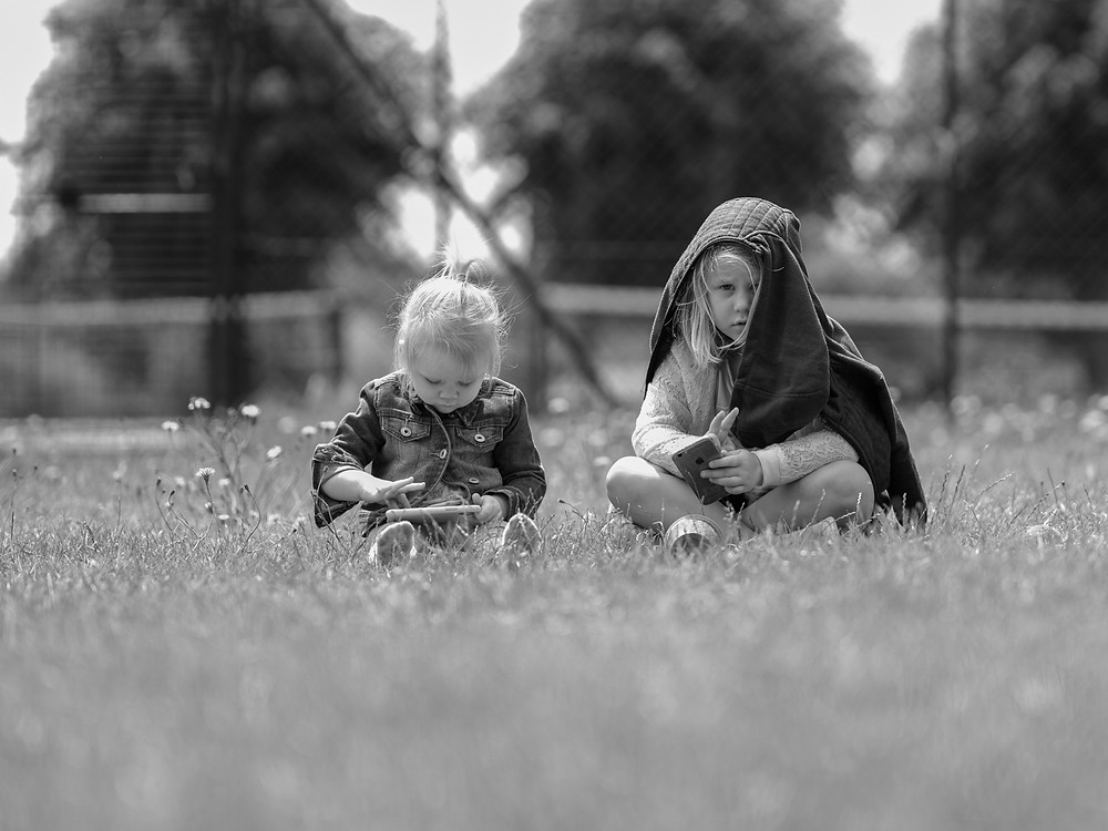 sisters sitting on th grass