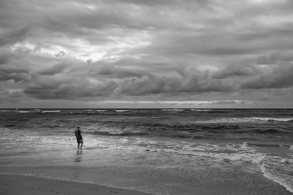 Man on morning stormy beach Punta Cana
