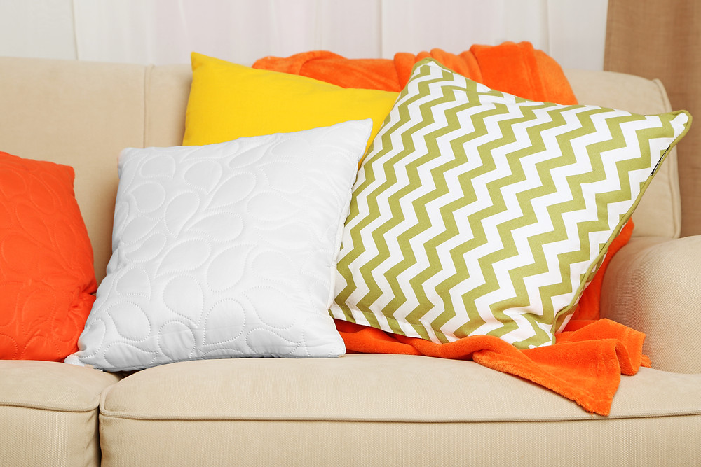 white, yellow and green pillows