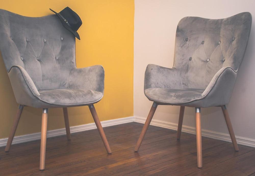 Two plush velvet chairs
