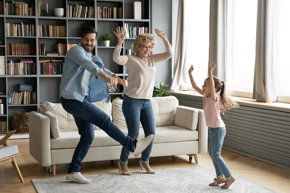 Mom and Dad dancing with young daughter