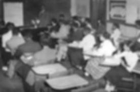 students inside long building.jpg