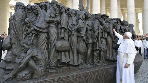 immigrant sculpture at St. Peter's with