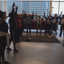 DTH's company artists teach positions of the arms at a car dealership