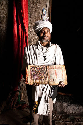 Priest showing very old book in Asheten Mariam monastery church
