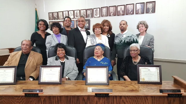 Flonzie and fellow Cantonians are honored at Canton City Hall by Mayor Arnel Bolden as Senator Kenny Wayne Jones, Chief of Police Vicky McNeil, family and other city officials looks on.