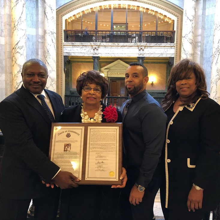Senator John Horhn recognizes Flonzie at the Mississippi State Capital surrounded by her son Darrell and daughter Cynthia.