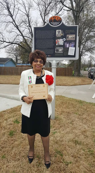 Delta State University and the Amzie Moore Museum Home honors Flonzie outside of the home of the late Amzie Moore.
