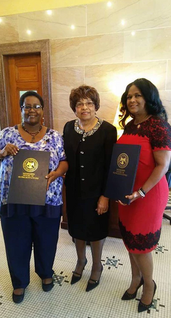 Representative Kathy Sykes and Representative Debra Gibbs honors Flonzie at the Mississippi State Capital.