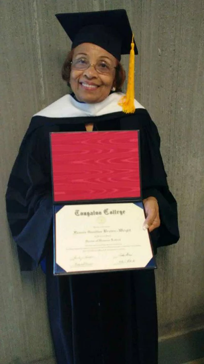 Flonzie poses with certificate after receiving an Honorary Doctorate of Humane Letters from Tougaloo College, 2018