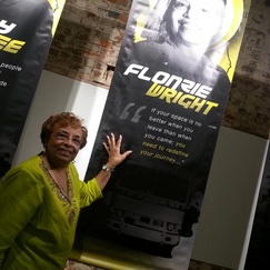 Flonzie poses at the Smith Robinson Museum next to her banner as part of a display honoring Mississippi trailblazers.