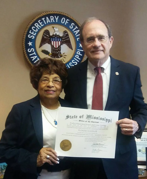 Secretary of State Delbert Hoseman presents Flonzie with a copy of her 1968 Certificate of Election, which was destroyed in a fire.