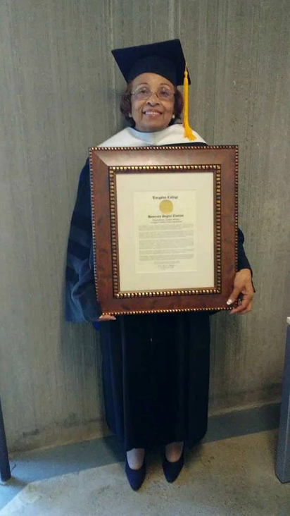 Flonzie displays certificate after receiving Honorary Doctorate of Humane Letters degree from Tougaloo College.