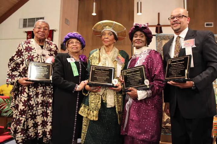 Flonzie presents awards to Rev. Wendell Paris, Dorothy Stewart, Dr. Alferdteen Harris and Artie Tate (standing in for his father, Arthur Tate, Sr.)