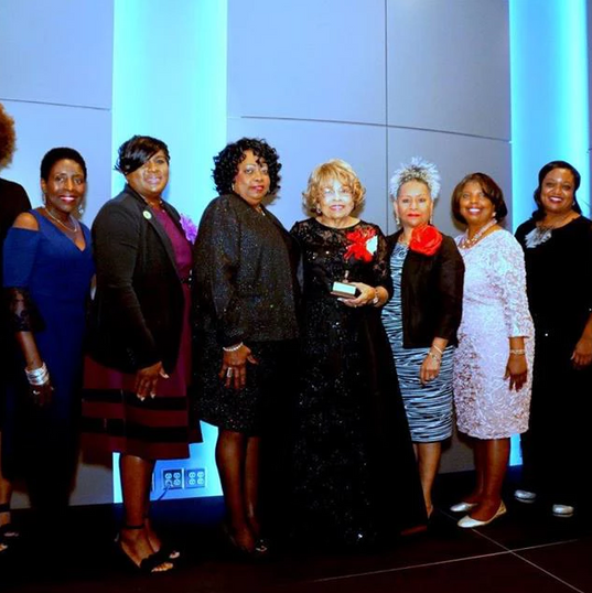 Members of Women For Progress celebrates with Flonzie at her 50th anniversary gala of her 1968 historic election.