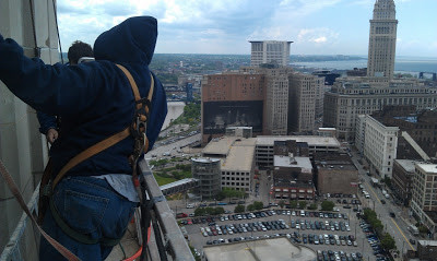 The crew inspecting the AT&T building in downtown Cleveland via a suspended swing stage.
