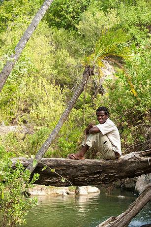 Guide Samson at a natural hot springs in Tanzania