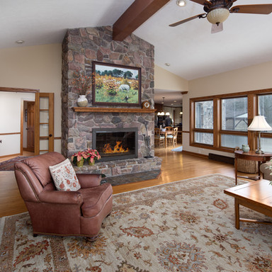 Large stone hearth fireplace in family room