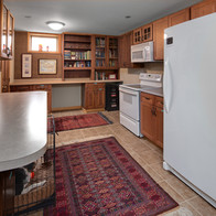 Another kitchen next to entertainment room