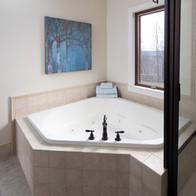 Large soaking tub in master bath