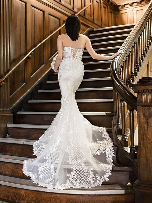 Mermaid lace corset wedding gown in ivory