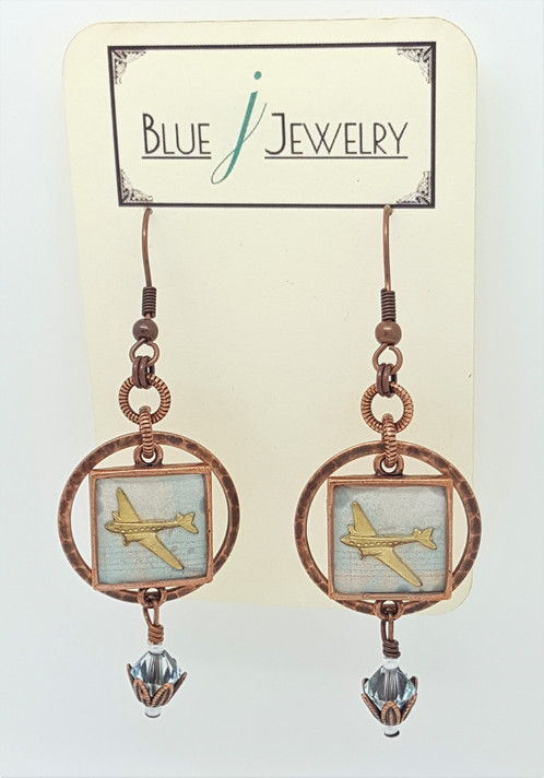 These Earrings Were Made By Placing A Background Of Light Blue And Peach Colored Paper Into Copper Plated Bezels Next The Br Airplane Charms Added