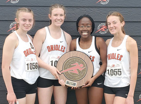 Girls' relay team capture school's first ever Howard Wood Dakota Relay title