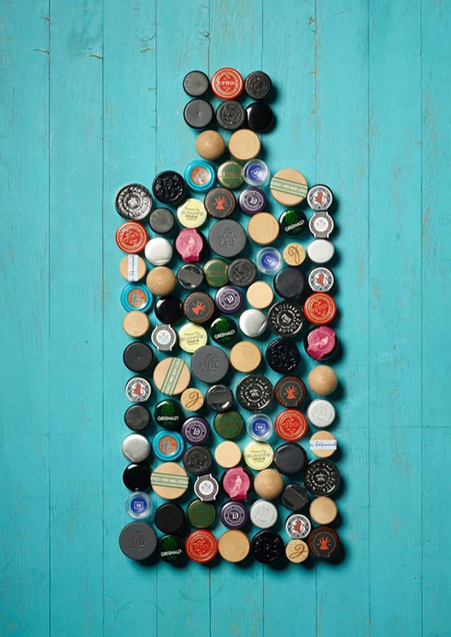 creative still life photography gin bottles caps