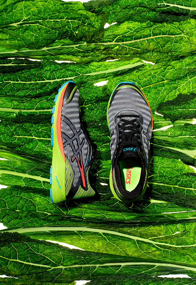 creative still life photography running shoes trainers kale background