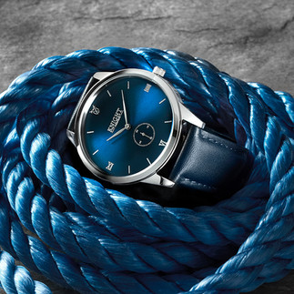 creative still life photography men's watch with blue face