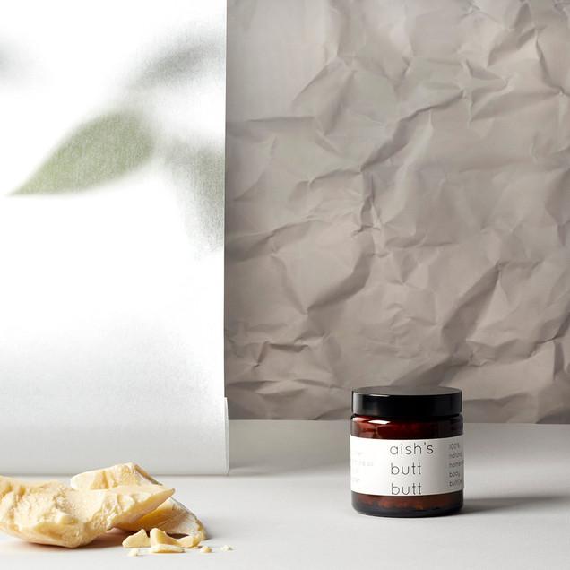 creative still life photography moisturiser jar with cocoa butter