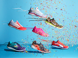 creative still life photography running shoes trainers with confetti