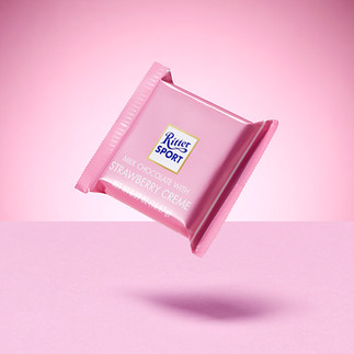 creative still life photography ritter sport strawberry chocolate on pink background