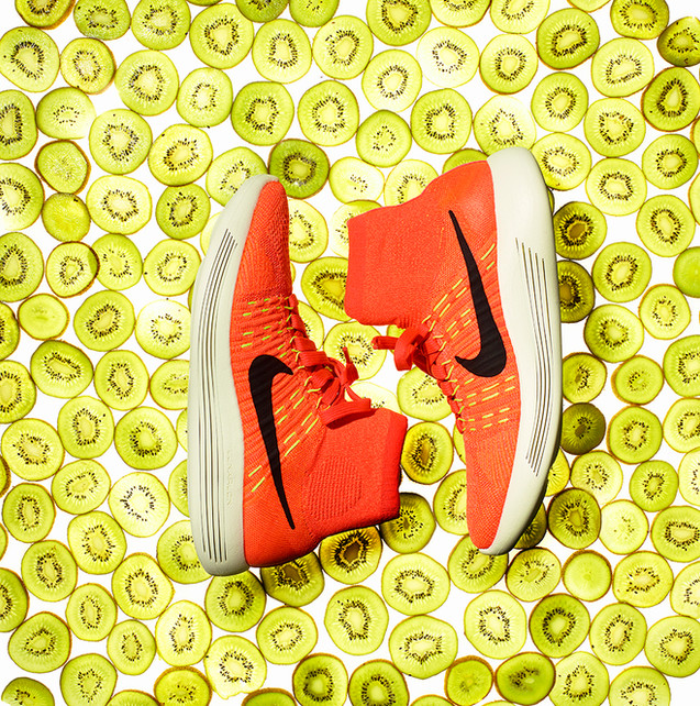 creative still life photography nike running shoes trainers kiwi background