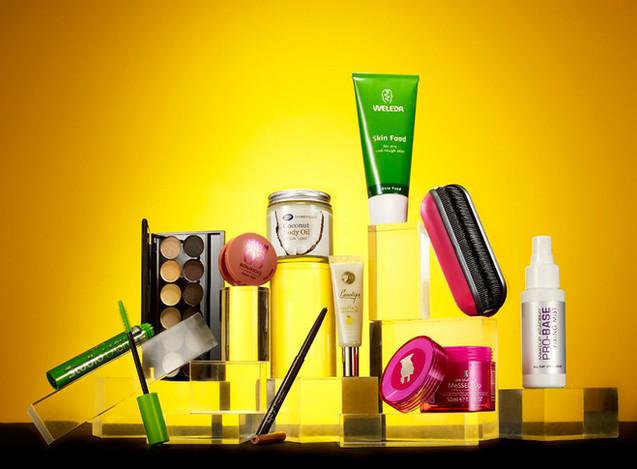 creative still life photography cosmetics arranged on acrylic blocks on yellow background