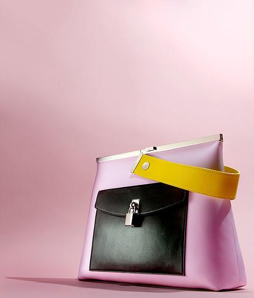 creative still life photography dior pink and black handbag