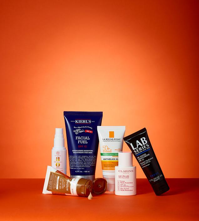 creative still life photography cosmetics on orange background