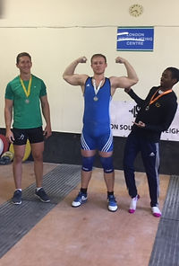 Matt (centre) winning his group at a London Weightlifting competition