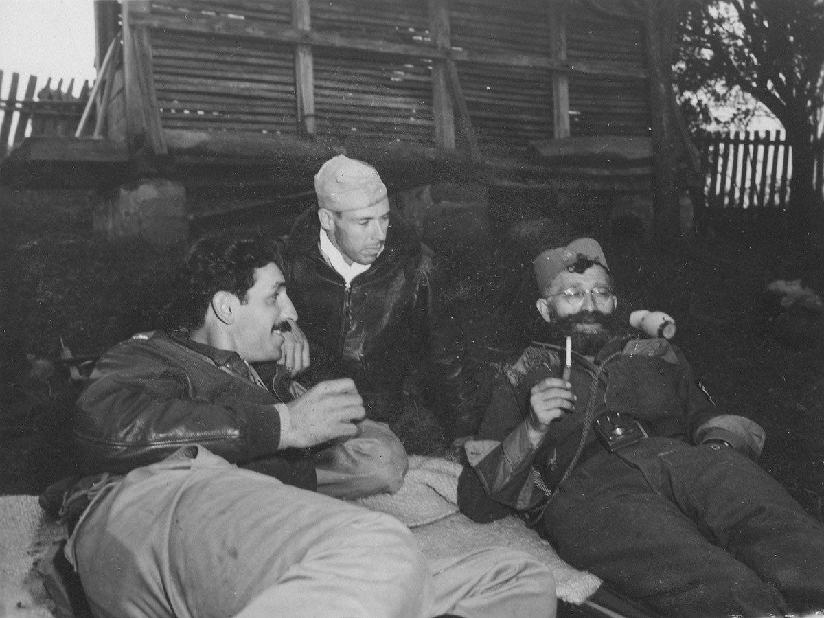 Stop for a rest at 05:30, 11. Sept. '44. Lt. Nick Lalich (OSS), photographer J.B. Allin, Gen. Draza Mihailovich.