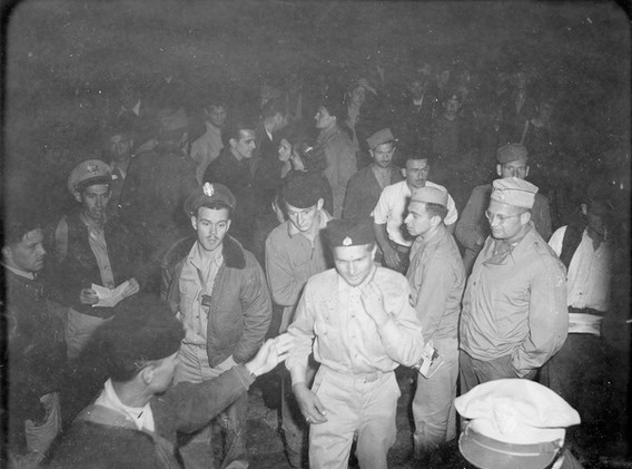 Typical scene - American airmen step aboard C-47 as names are checked off in preparation for evacuation. 17 American airmen and several other nationalities evacuated by two C-47, 5. sept. '44.