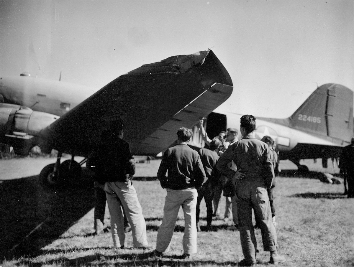 Emergency evacuation, 17. September '44, Koceljeva, near Valjevo, Serbia. The second C47 clipped off the top of haystack on coming in.