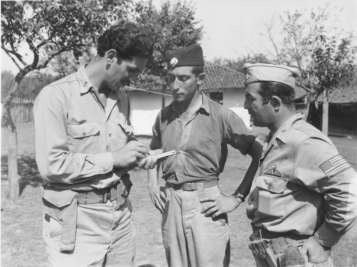 Lt. Lloyd G. Hargrave (center) being interrogated by Lt. Nick Lalich (left) and Lt. Mike Rajacich (right). Lt. Hargrave from Virginia is a P51 pilot. Shot down on 3. Sept. '44, probably by small arms fire, landed 10 miles south of Belgrade. Mission was straffing targets of opportunity over Yugoslavia. Arrived at evacuation center on 9. Sept. '44, evacuated on 17. Sept.