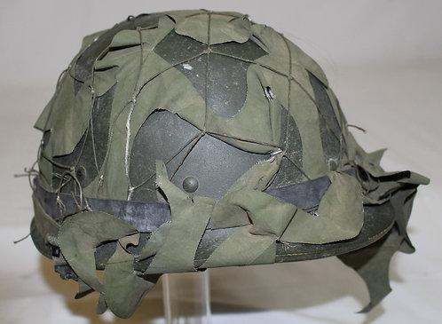 Desert Storm Iraqi Army green combat helmet with camo net