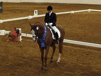Anna and Gus bow to judge at CBLM Championship.